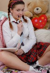 Adorable schoolgirl Lara masturbates